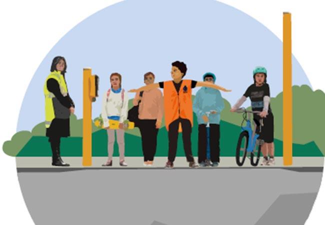 school-warden-at-traffic-light-crossing